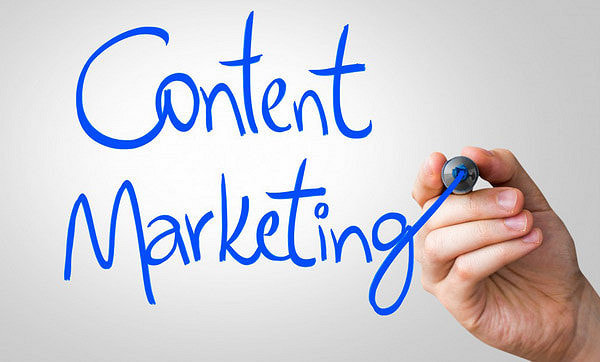 The words Content Marketing writes in a blue marker